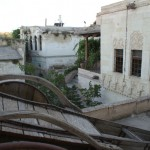 The neighborhood, including an old cart perched on one of our terraces.